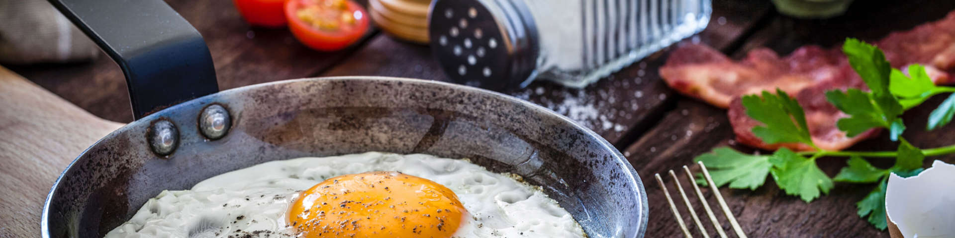 A sunny side up egg in a frying pan.