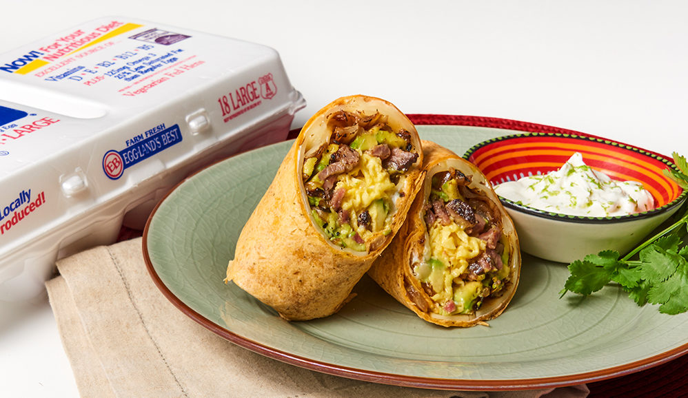 Steak and Egg Burrito with Caramelized Onions and Avocado Cream
