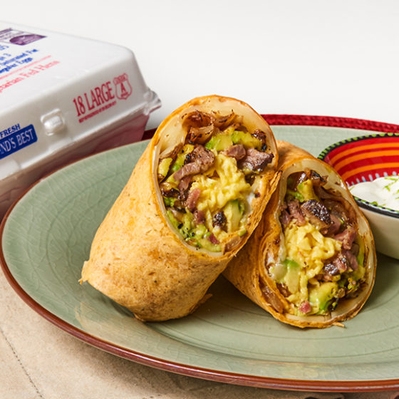 Photo of Steak and Egg Burrito with Caramelized Onions and Avocado Cream