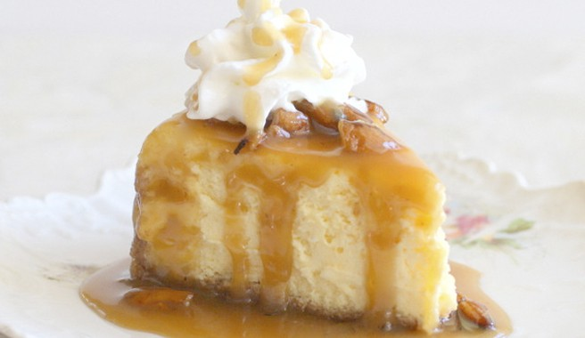 Eggnog Cheesecake with Honey Bourbon Praline Sauce