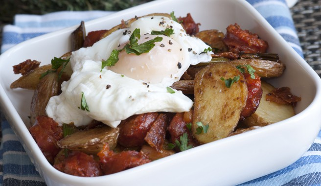 Spicy Poached Egg Over Cheddar Fried Potatoes