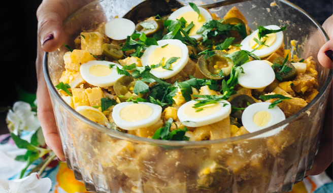 Potato salad topped with jalapenos and sliced hard boiled EB eggs