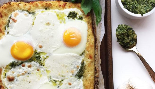 Cauliflower Crust Pizza with Arugula, Pesto, and Sunny Side Up EB Eggs